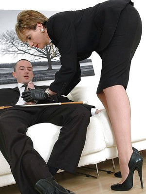 Fully clothed mature fetish lady in leather gloves gives a sloppy handjob