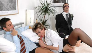 Mature femdom gives a blowjob with witness of a blindfolded guy