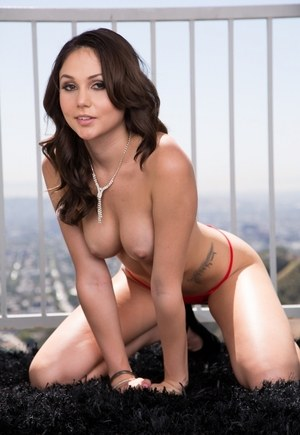 Cute solo girl Ariana Marie shows off her sexy legs while removing her clothes